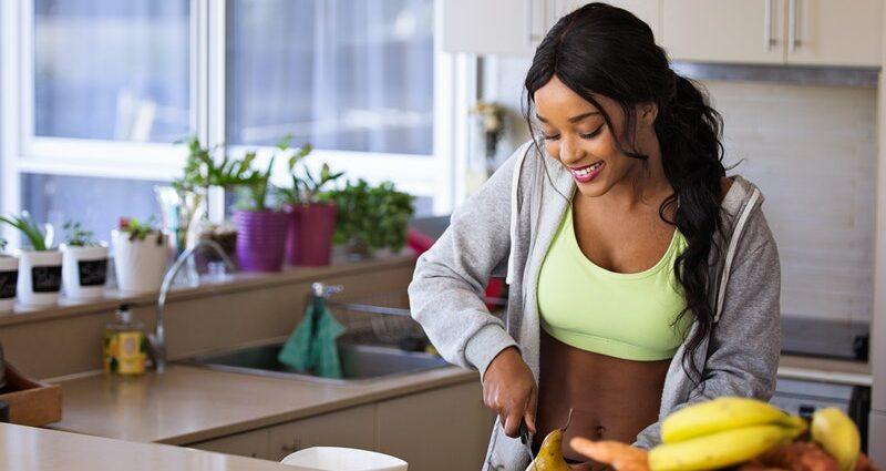Woman Slicing Healthy Food